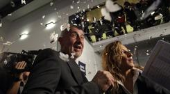 Andrej Babis is sprayed with confetti, after most of the votes were counted in the parliamentary elections in Prague (AP Photo/Petr David Josek)