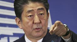 Japan's prime minister Shinzo Abe Abe pledged to tackle what he called Japan's two national crises, the military threat from North Korea and an ageing and shrinking population (AP)