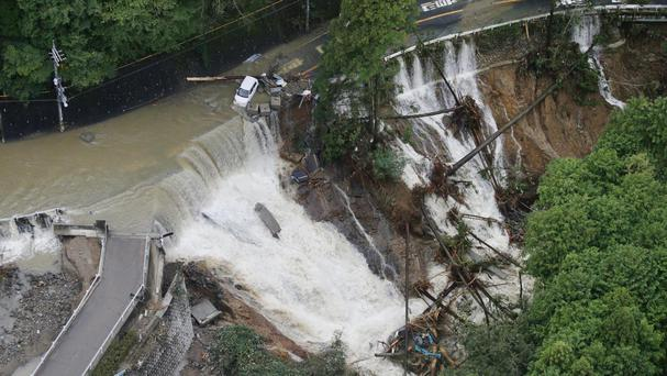 A collapsed road in Kishiwada, Osaka, after heavy rain brought by a powerful typhoon. (Yuki Sato/Kyodo News/AP)