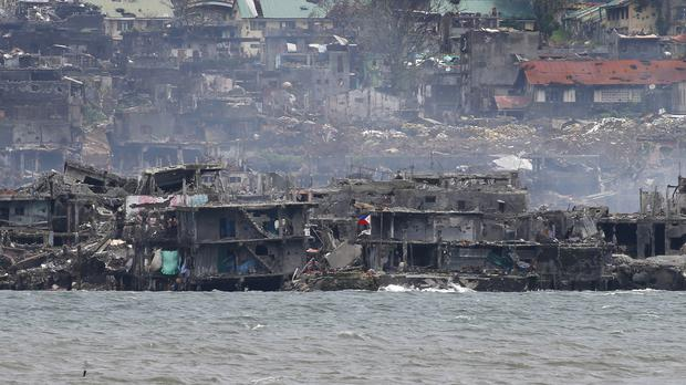 Smoke rises from the area where pro-Islamic group militants had been making a final stand amid a military offensive with government troops in Marawi city (AP)
