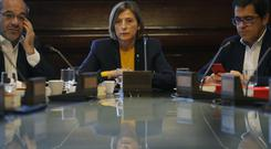 President of the Catalan parliament Carme Forcadell, centre, gathers to discuss with parliament representatives their next move after the Spanish government announced plans to remove members of the region's pro-independence government (AP)