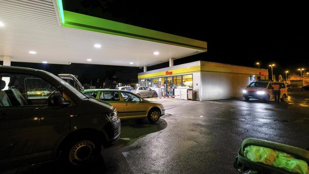 Police attend the scene after several people were injured in an axe attack at a petrol station in Flums (AP)