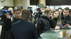 Journalists gathered at the entrance of the Ekho Moskvy radio station's office after Ms Felgenhauer was attacked (AP)