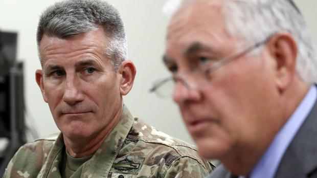 Rex Tillerson speaks to reporters with General John Nicholson, commander of Resolute Support, at Bagram (AP)