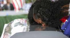 Myeshia Johnson kisses the casket of her husband, Sgt La David Johnson, during his burial service (AP)