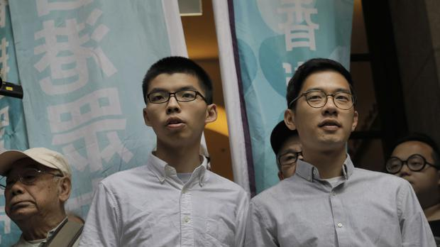Joshua Wong and Nathan Law leave the Court of Final Appeal (AP)