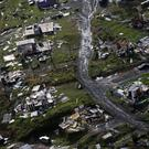 Debris scatters a destroyed community in the aftermath of Hurricane Maria in Toa Alta, Puerto Rico (AP)