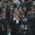 The judge and lawyers arrive at Kuala Lumpur airport in Sepang, Malaysia (AP)