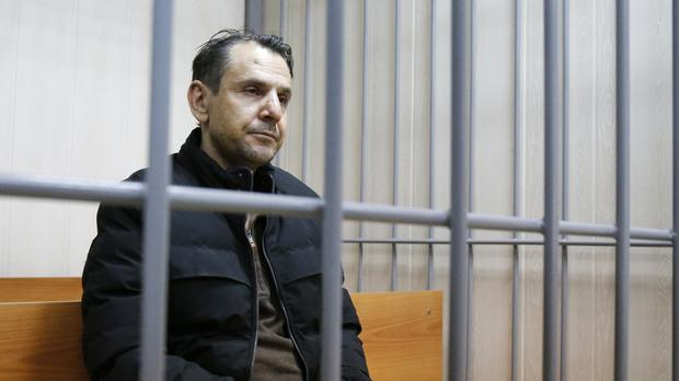 Boris Grits sits in a holding cell in a courtroom in Moscow (AP)