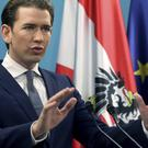 Sebastian Kurz speaks during a news conference in Vienna (AP)