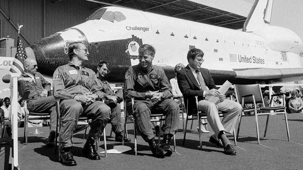 Paul Weitz, second right, with other crew members in front of the space shuttle Challenger in 1982 (AP)