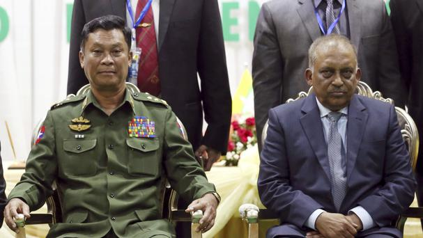 Burmese home affairs minister General Kyaw Swe with Bangladeshi counterpart Asaduzzaman Khan (AP)