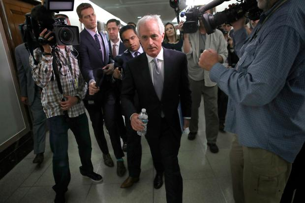 Senator Bob Corker walks to a committee hearing after speaking to members of the press on Capitol Hill about US President Donald Trump. Photo: Getty Images