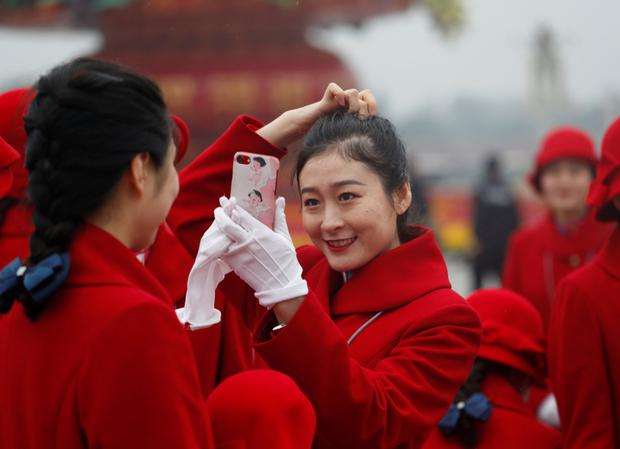 Ushers at Tiananmen Square for the opening of the National Congress of the Communist Party of China. Photo: Reuters