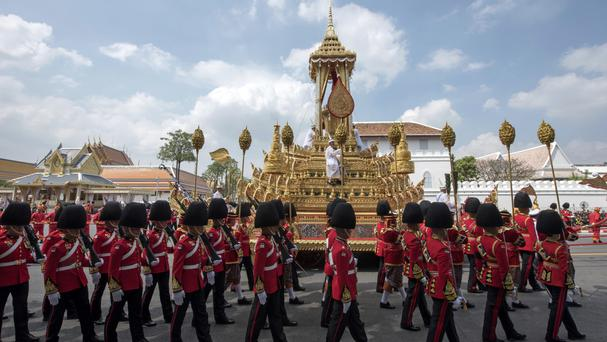 The symbolic urn is transported during the funeral procession of late Thai King Bhumibol Adulyadej in Bangkok (AP)