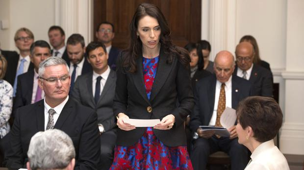Jacinda Ardern reads the oath as she is sworn in as New Zealand prime minister (New Zealand Herald/AP)