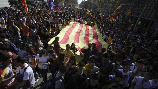 Protesters march during a protest against the Spanish government in Barcelona (AP)