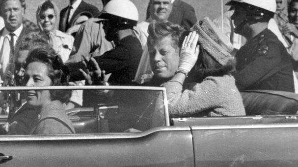 President John F Kennedy waves from his car in a motorcade in Dallas (AP Photo/Jim Altgens, File)