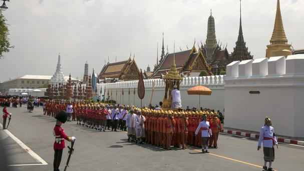 A procession carrying King Bhumibol Adulyadej's ashes to special locations for further Buddhist rites (AP)