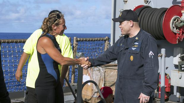 Jennifer Appel is welcomed aboard USS Ashland by Command Master Chief Gary Wise (Jonathan Clay/US Navy/AP)