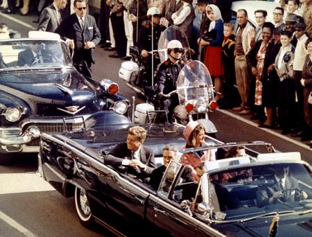President John F Kennedy and his wife Jacqueline ride in a limousine moments before he was assassinated, in Dallas, Texas, on November 22, 1963. Photo: Walt Cisco, AP