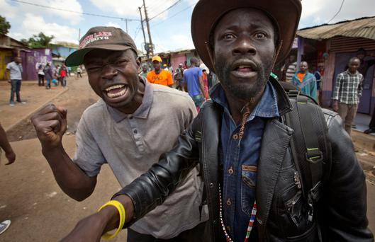 Rising Anger: Supporters of the opposition demand the resignation of a local Kibera police chief over police cruelty. Photo: AP