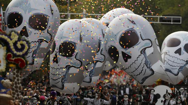 Performers participate in the Day of the Dead parade on Mexico City's main Reforma Avenue (AP Photo/Eduardo Verdugo)