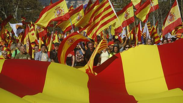 Nationalist activists protest with Spanish and Catalan flags during the mass rally against Catalonia's declaration of independence (AP)