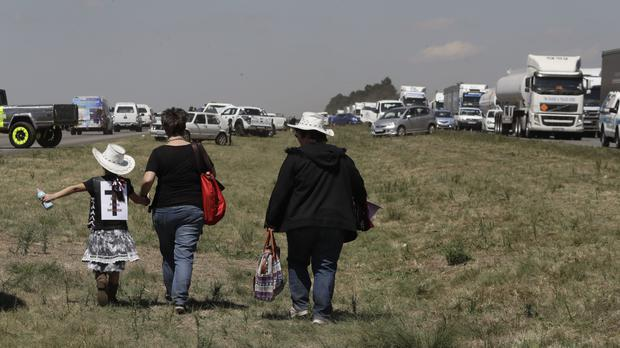 The freeway is blockaded between Johannesburg and Vereeniging (AP)