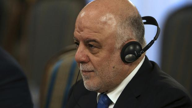 Haider al-Abadi said the central government is closely monitoring events in Irbil and Dahuk (AP)
