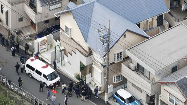 The apartment where police found dismembered bodies in fridges in Zama city (Kyodo News/AP)