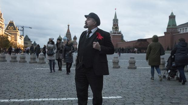 Sergei Soloviev, a professional doppelganger for Vladimir Lenin, at work in Red Square, Moscow (AP)