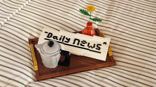 A newspaper and pot of coffee inside the Lego house in Billund, Denmark (Airbnb/PA)