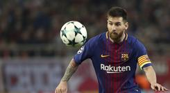Lionel Messi plays for Barcelona during a Champions League match (AP/Petros Giannakouris)