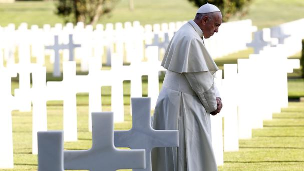 Pope Francis stands next to marble crosses at the American military cemetery in Nettuno, Italy (Stefano Rellandini/Pool Photo via AP)