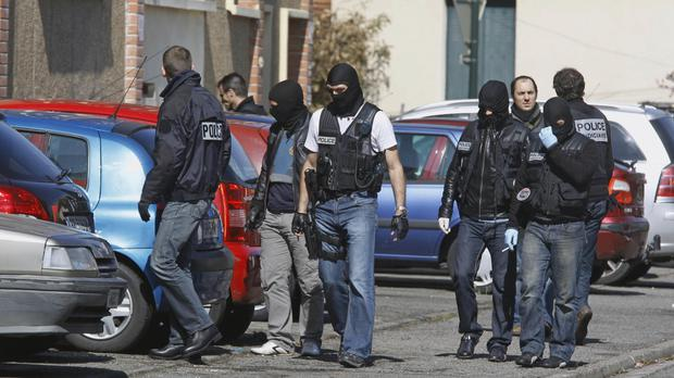 Police search for clues outside Mohamed Merah's apartment building in Toulouse, southwestern France (AP/Remy de la Mauviniere)