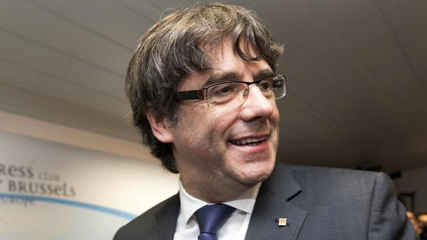 Sacked Catalan president Carles Puigdemont flew to Brussels (AP)