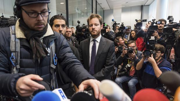 Spokesman for the Brussels' prosecutor's office Gilles Dejemeppe, centre, arrives to address the media (AP/Geert Vanden Wijngaert)