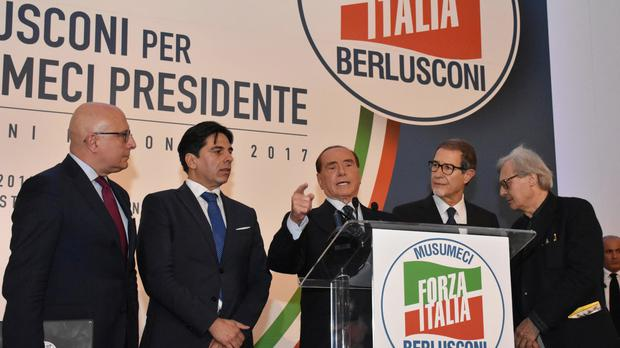 Silvio Berlusconi giving a speech during an electoral meeting to support the centre-right Forza Italia candidate Nello Musumeci (Ansa/AP)