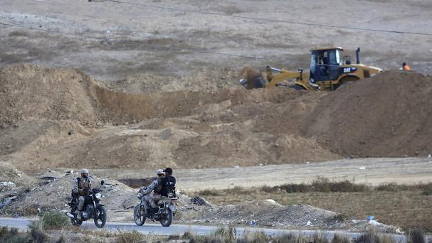 A Palestinian bulldozer searching the destroyed tunnel (AP)