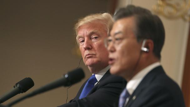 Donald Trump listens to South Korean President Moon Jae-in during a joint news conference (AP)