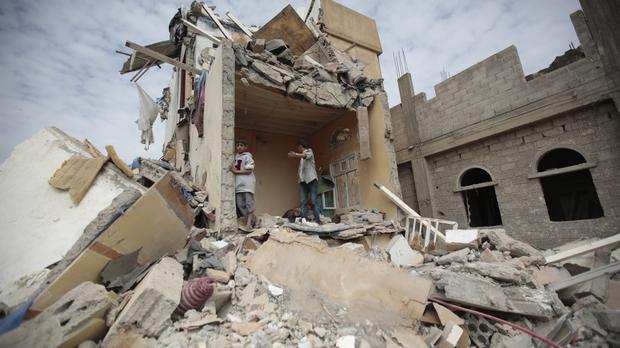 The rubble of a house destroyed by Saudi-led air strikes in Sanaa (AP)
