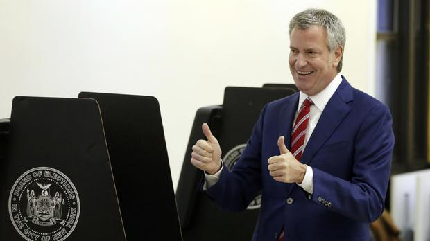 New York Mayor Bill de Blasio gives a double thumbs-up after voting at the Park Slope Library, Brooklyn, on Tuesday (AP Photo/Richard Drew)