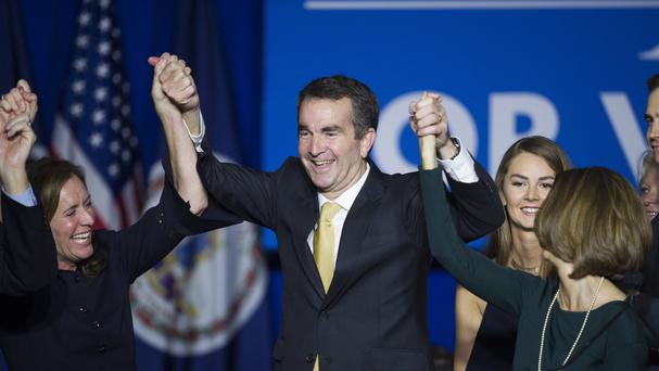 Virginia governor-elect Ralph Northam celebrates his election victory with his wife Pam and daughter Aubrey (AP)