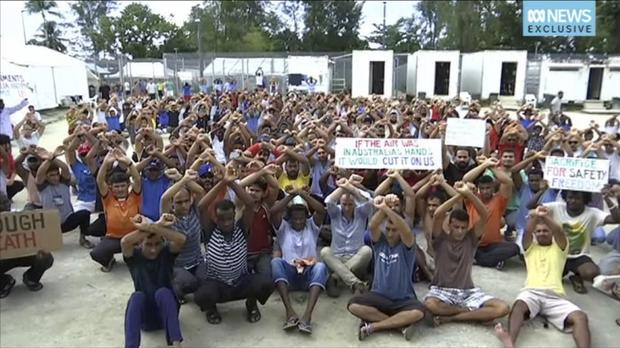 Asylum seekers protest against the possible closure of their detention centre on Manus Island, Papua New Guinea (AP)