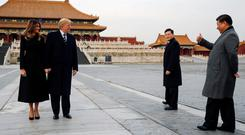 US President Donald Trump and first lady Melania get a thumbs-up from China's President Xi Jinping in the Forbidden City in Beijing Photo: Reuters