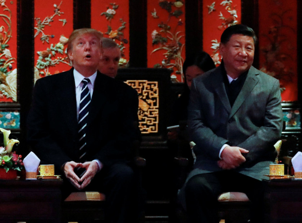 US President Donald Trump and China's President Xi Jinping watch an opera performance at the Forbidden City in Beijing, China. Photos: Reuters/Jonathan Ernst