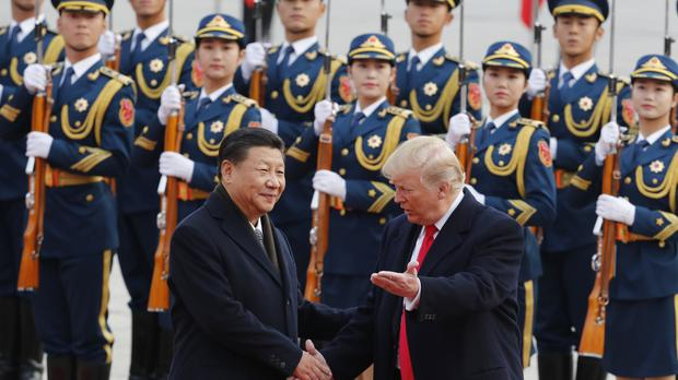 Donald Trump and Chinese President Xi Jinping attend a welcome ceremony at the Great Hall of the People in Beijing ahead of talks on Thursday (AP Photo/Andy Wong)