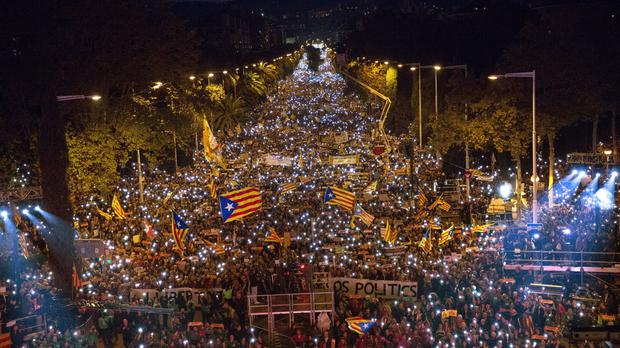 Demonstrators gather during a protest calling for the release of Catalan jailed politicians, in Barcelona (AP)
