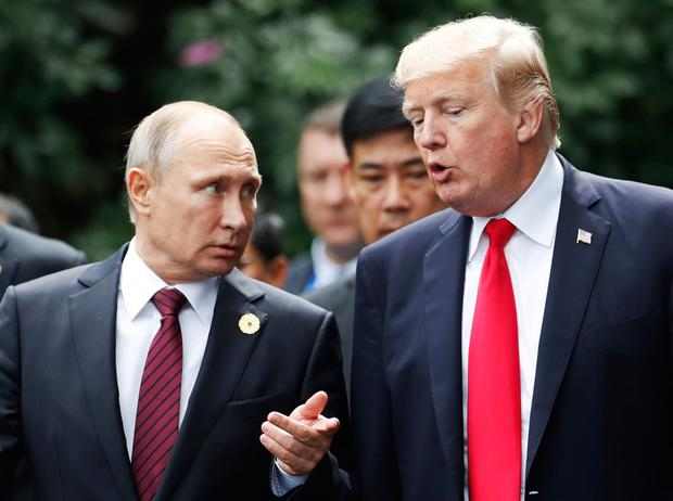 US president Donald Trump and Russia's president Vladimir Putin talk during the APEC Summit in Danang, Vietnam, yesterday. Photo: Jorge Silva/AP